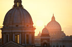 Domes of San Carlo al Corso Church and St. Peter's Basilica